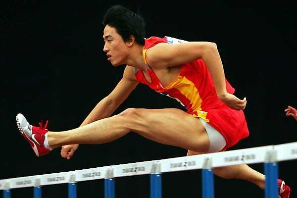 Liu Xiang wins his first round heat at Asian Games (Getty Images)