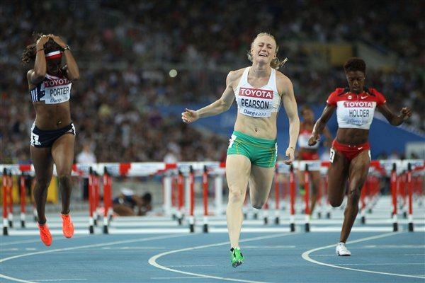 Sally Pearson of Australia crosses the line in the women's 100 metres hurdles final (Getty Images)