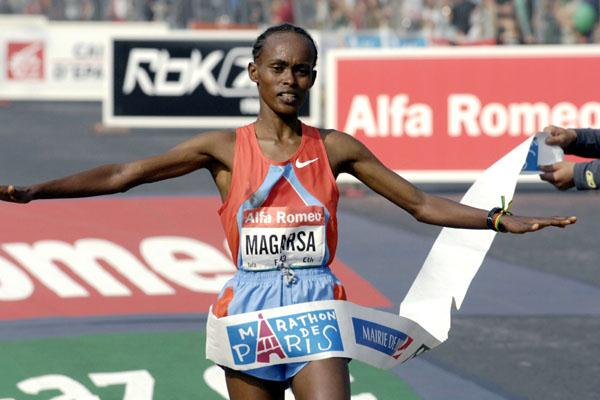 Magarsa Tafa (ETH) crosses the line in a PB 2:25:07 at the Paris Marathon (Stephane de Sakutin/AFP/Getty Images)