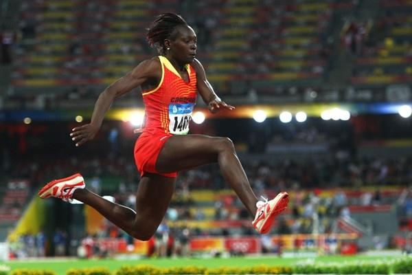Francoise Mbango of Cameroon flies through the air, landing at an Olympic record of 15.39m (Getty Images)