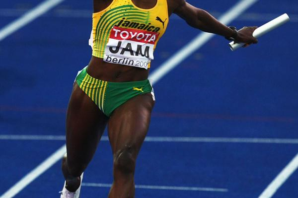 Kerron Stewart crosses the line to secure another gold medal for Jamaica in the women's 4x100m at the IAAF World Championships (Getty Images)