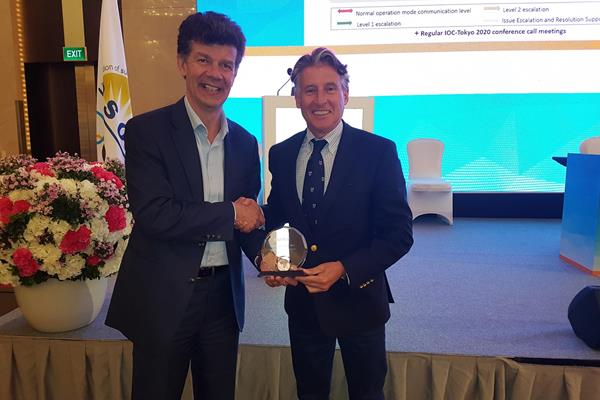 IAAF President Sebastian Coe receives the Sportcal Global Sports Event of the Year award from managing director Mike Laflin (Sportcal)