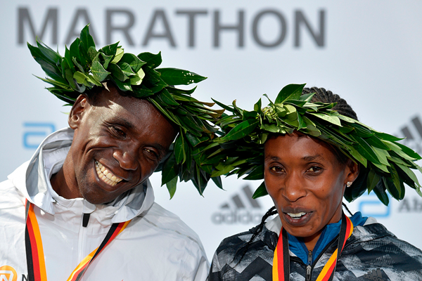 Eliud Kipchoge and Gladys Cherono after winning the Berlin Marathon (AFP / Getty Images)