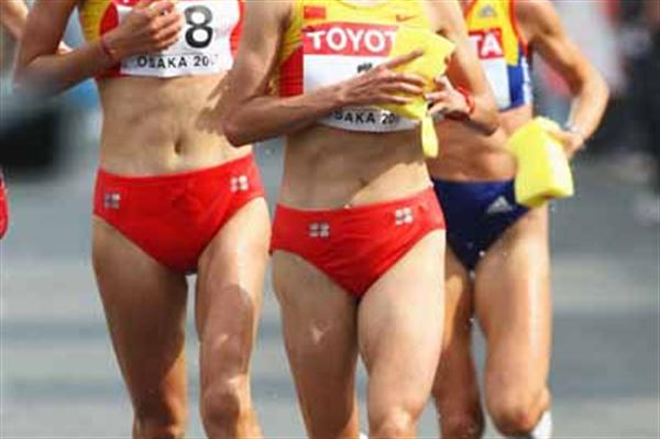 Xiaolin Zhu and Chunxiu Zhou of China compete in the Women's Marathon (Bongarts/Getty Images)