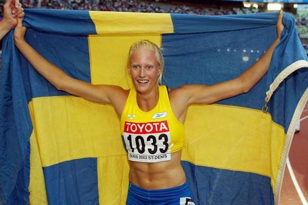 Carolina Kluft celebrates winning the women's heptathlon (Getty Images)