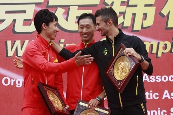 2010 Race Walking Challenge Final men's podium (l to r) -  runner-up Chu Yafei (CHN), race winner Zhen Wang (CHN), and Giorgio Rubino (ITA) (organisers)