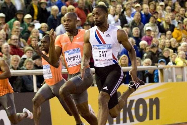 Tyson Gay powers by Asafa Powell en route to a 9.79w victory in Stockholm (Hasse Sjögren)