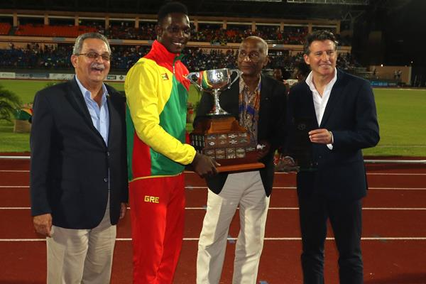 NACAC President Victor Lopes, Carifta Games founder Austin Sealy and IAAF President Sebastian Coe after Grenada's Anderson Peters was presented with the Austin Sealy award to the 45th Carifta Games' Most Outstanding Athlete Award (Organisers)