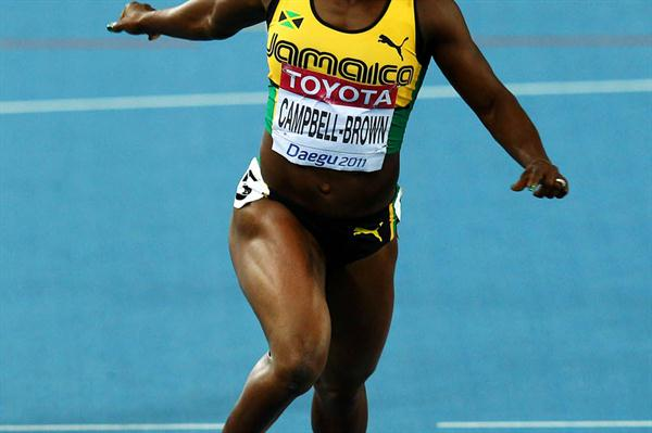 Veronica Campbell-Brown of Jamaica crosses the finish line to win the women's 200 metres final  (Getty Images)
