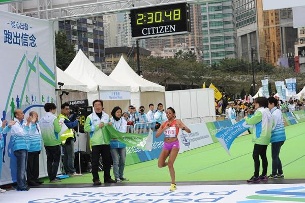 Ethiopia's Misiker Mekonnin Demissie wins at the 2013 Standard Chartered Hong Kong Marathon  (organisers)