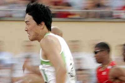 Liu Xiang - a side view of the World record breaker as he runs in Lausanne (AFP / Getty Images)