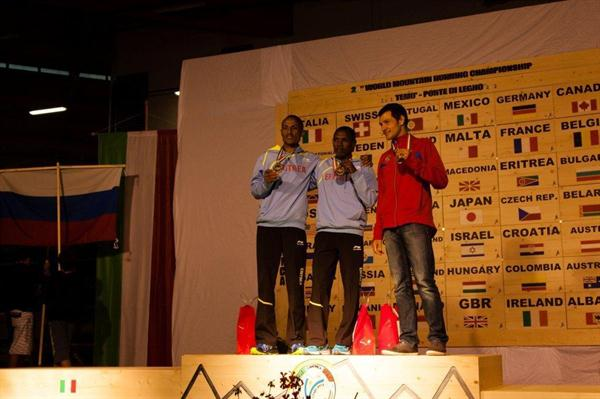 Men's podium at Ponte di Legno, from left: silver medallist Azeria Teklay, winner Petro Mamo, and bronze medallist Andrey Safranov (RUS) (WMRA)