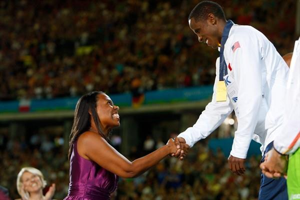 Marlene Dortch the granddaughter of Olympic Legend Jesse Owens presents Dwight Phillips of the United States the gold medal for his Long Jump victory (Getty Images)