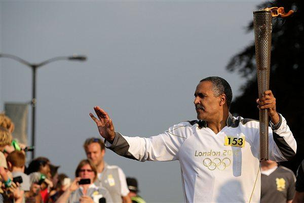Daley Thompson carrying the Olympic torch (Getty Images)