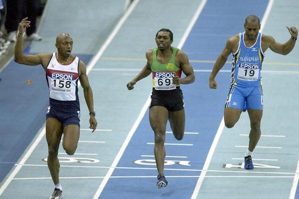Marlon Devonish (GBR) outsprints Joseph Batangdon in the men's 200m final (Getty Images)