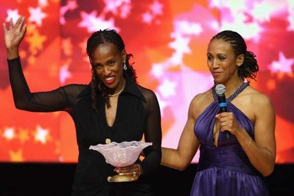 Jackie Joyner-Kersee of United States (left) receives an award representing 80 years of Women Athletes at the Olympic Games during the IAAF World Athletics Gala (Getty Images)