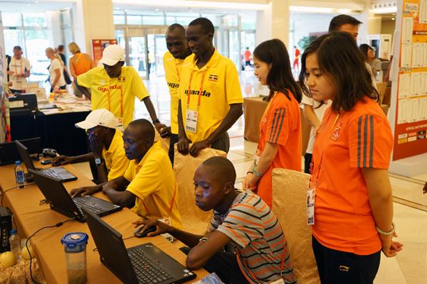 Members of the Ugandan team visit the IAAF's outreach stand in Beijing (IAAF)