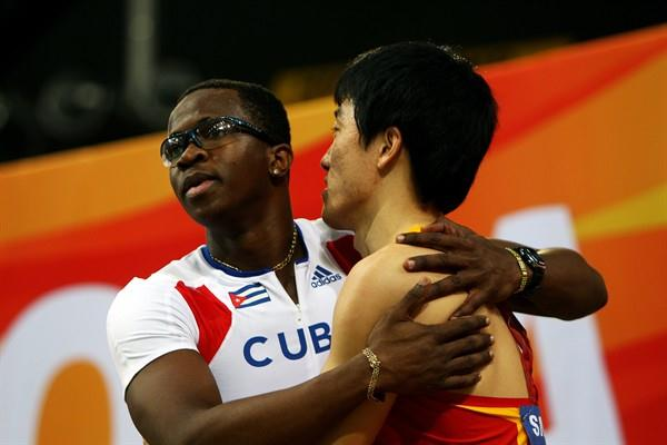 Dayron Robles of Cuba after his victory in the men's 60m Hurdles, hugs Liu Xiang of China the defending champion from China (Getty Images)