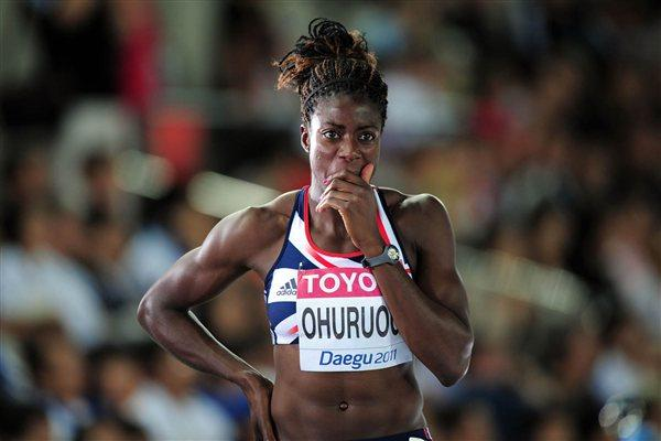 Christine Ohuruogu of Great Britain looks on in dejection after being disqualified for a false start in the women's 400 metres heats during day one (Getty Images)