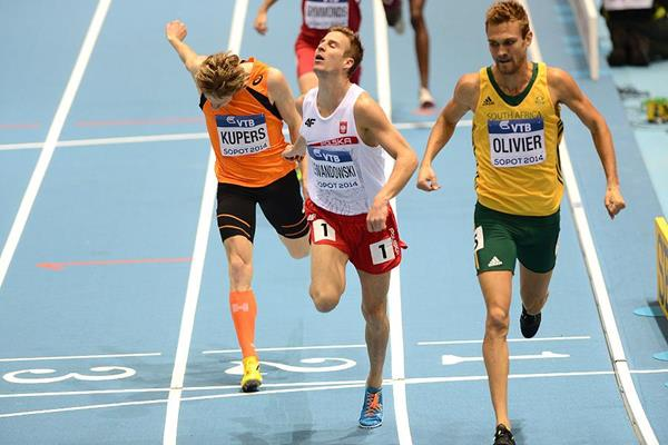 Marcin Lewandowski (centre) in the 800m at the IAAF World Indoor Championships Sopot 2014 (AFP / Getty Images)