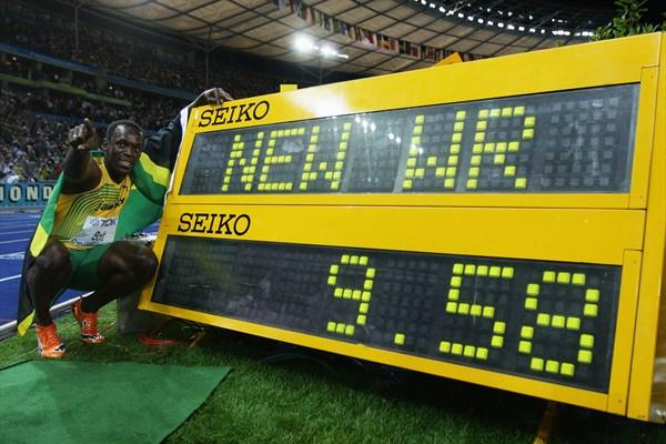 Usain Bolt of Jamaica celebrates setting a world record while winning the 100m at the 12th IAAF World Athletics Championships (Getty Images)