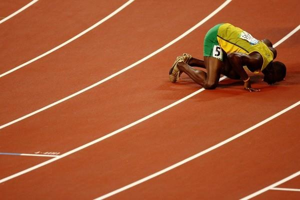 Usain Bolt kisses the track in Beijing upon which he set two individual sprint World records (100m and 200m) and one team (4x100m) (Getty Images)