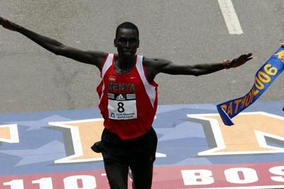 The clock's a second off, but no matter - Robert Cheruiyot celebrates his course record at the Boston Marathon (Getty Images)