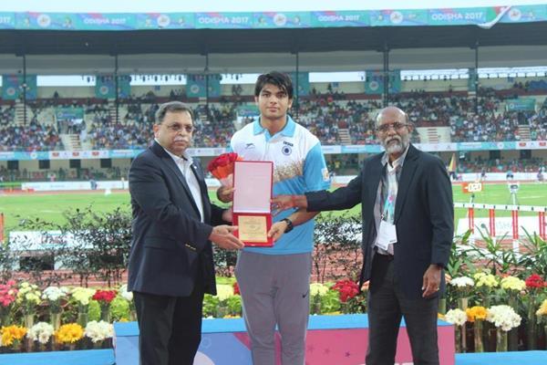 From left: Adille Sumariwalla, President, Athletics Federation of India (AFI); Neeraj Chopra; C K Valson, AFI Secretary General (AFI)