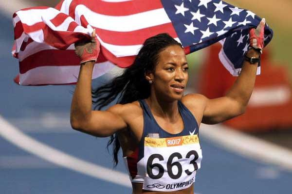 Mikele Barber after her win at the Pan-Am Games 100m (AFP / Getty Images)