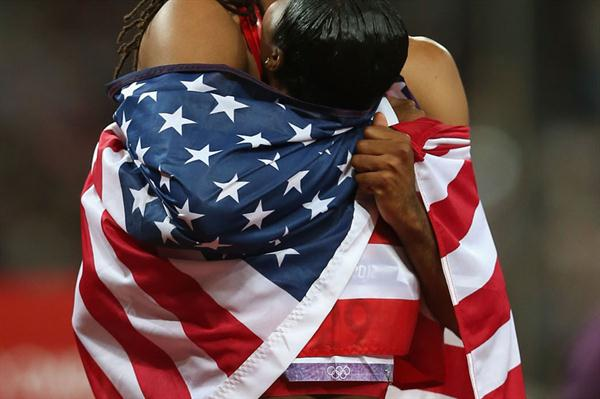 Jason Richardson of the United States hugs Carmelita Jeter of the United States after the Men's 110m Hurdles Final  of the London 2012 Olympic Games on 8 August 2012 (Getty Images)