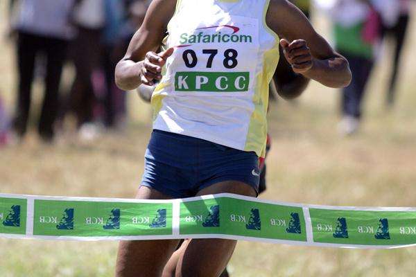 Jane Mwikali crosses the finish line to win the women's 8km race at the Kenya Prisons Cross Country Championships in Ruiru on Saturday (MOHAMMED AMIN/ DAILY NATION)