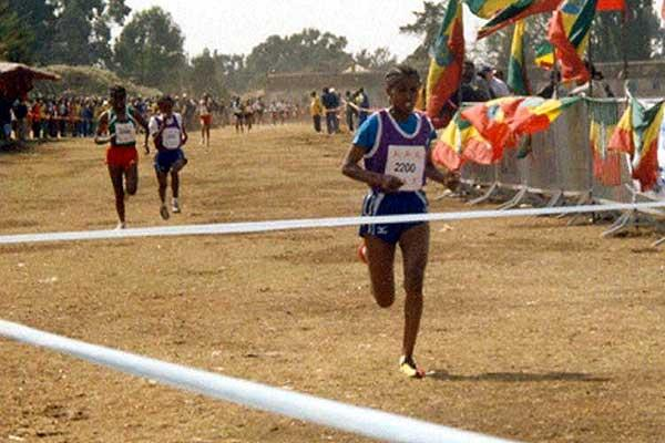 Kidane completes double at 2004 East African XC Champs (M. Wessenyeleh)