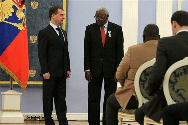 President Dmitry Medvedev with IAAF President Lamine Diack, wearing Russian Order of Friendship, in Moscow, 22 Nov 2011 (ARAF)