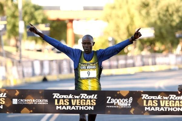 Christopher Toroitich breaks the tape at the Rock n Roll Las Vegas Marathon (Victah Sailer)