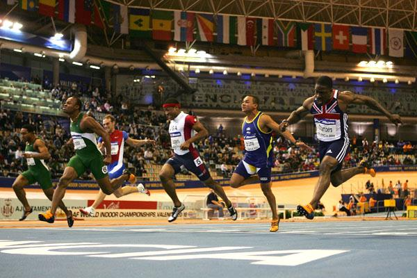 Olusoji Fasuba stretches away from the rest of the field to win the men's 60m title (Getty Images)