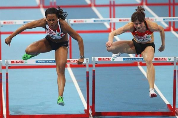 Tiffany Ofili and Carolin Nytra en route to her virtual dead heat in Paris. Nytra got the nod as both clocked 7.80 (Getty Images)