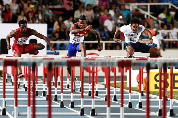 Matteo Ngo (left) en route to winning the boys' 100m hurdles at the IAAF World Youth Championships, Cali 2015 (Getty Images)