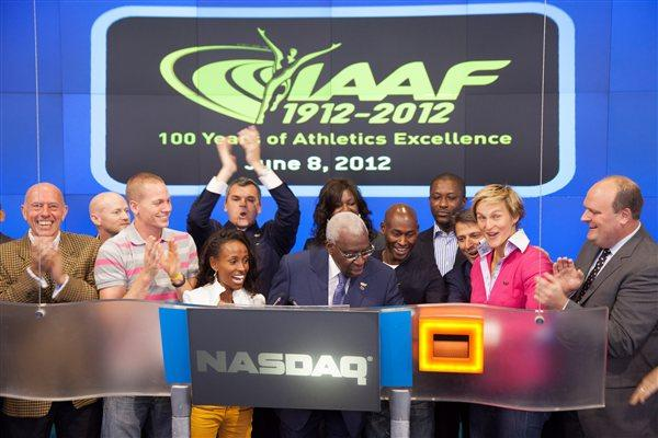 IAAF President Lamine Diack rings the final bell at NASDAQ (NASDAQ)