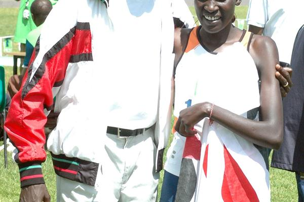 Pauline Korikwiang poses with Kenya's five times world cross country champion Paul Tergat after she won the eight kilometre women's race at the third Athletics Kenya cross country champions meeting in Meru, eastern Kenya (Elias Makori)