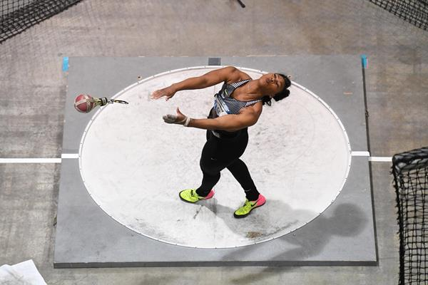 Gwen Berry throwing a world best in the 20-pound weight throw (Kirby Lee)