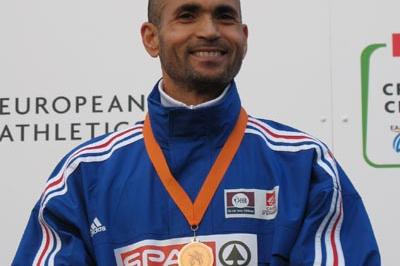 Driss Maazouzi of France celebrating his bronze medal performance at the 2005 European Cross Country Championships (Bob Ramsak)