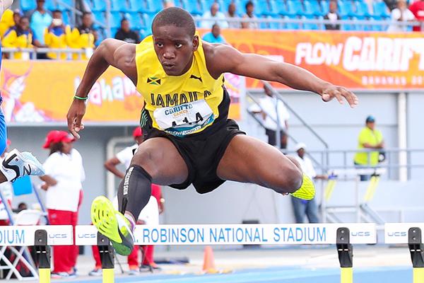 Rovane Williams on his way to winning the 400m hurdles at the Carifta Games (Leo Hudson)
