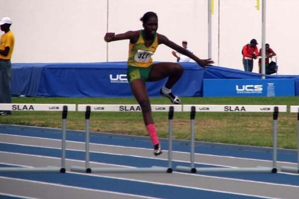 Janieve Russell (JAM) closes out a CARIFTA 300m Hurdles record (Anthony Debeauville)