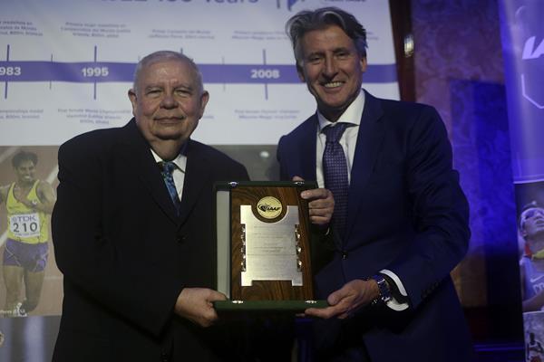 Roberto Gesta De Melo receives an IAAF Commemorative Plaque from IAAF President Sebastian Coe - CONSUDATLE Centennial Dinner, Gran Salon, Panamerican Hotel, Buenos Aires (Getty Images for IAAF)