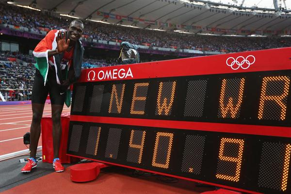 David Lekuta Rudisha of Kenya celebrates next to the clock after winning gold and setting a new world record in the Men's 800m Final on Day 13 of the London 2012 Olympic on 9 August 2012 (Getty Images)