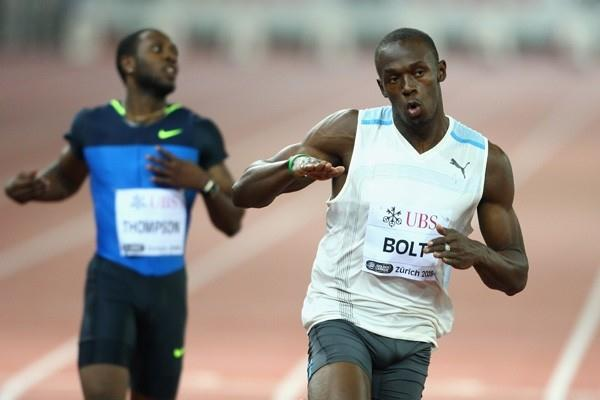 Usain Bolt runs 9.83 into a headwind to win the men's 100m (Getty Images)