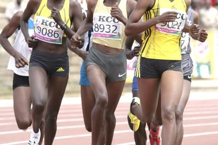 Irene Jelagat (right) on the way to upsetting Olympic 1,500m champion Nancy Jebet Lagat (8932) at the New KCC National Trials for the 2009 World Championships in Athletics at the Nyayo National Stadium in Nairobi (Elias Makori)
