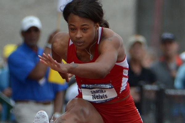 Sharika Nelvis winning the 100m hurdles at the 2014 NCAA Championships (Kirby Lee)