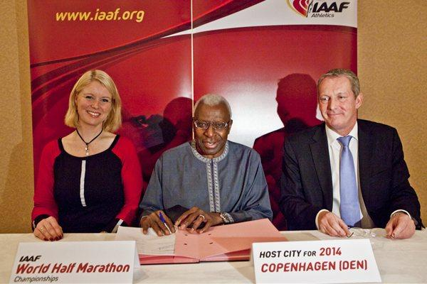 IAAF President Lamine Diack (c), with Copenhagen Mayor of Sport and Culture Pia Allerslev, and Lars Lundon after the city's winning bid was announced to host the 2014 IAAF World Half Marathon Championships (Philippe Fitte)