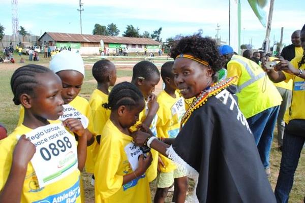 Tegla Loroupe helps the girls before their race in Kapenguria (TLPF)